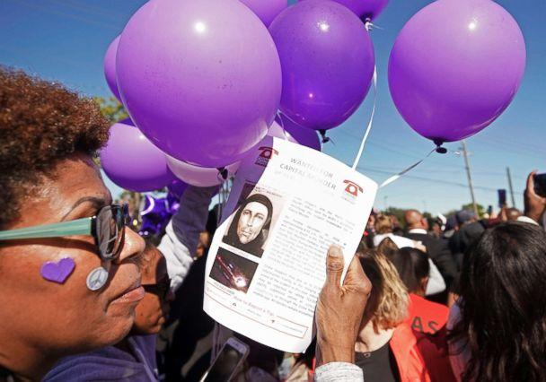 PHOTO: Donna Thomas holds a flyer about the shooting suspect as she attends a community rally for seven-year-old Jazmine Barnes in Houston, Jan. 5, 2019. (Melissa Phillip/Houston Chronicle via AP)