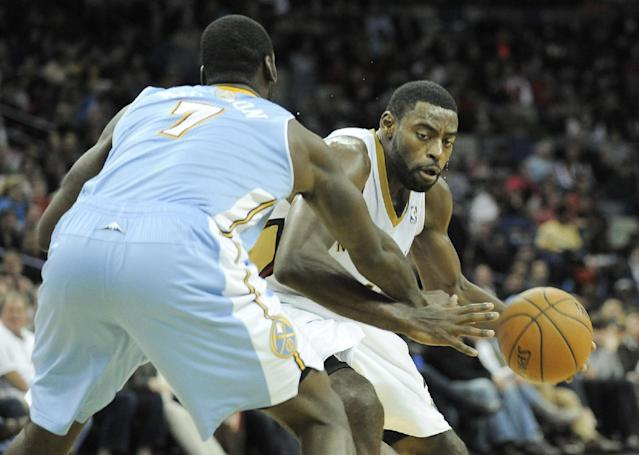 New Orleans Pelicans guard Tyreke Evans, right, drives to the basket against Denver Nuggets forward J.J. Hickson (7) in the second half of an NBA basketball game in New Orleans, Friday, Dec. 27, 2013. New Orleans won 105-89. (AP Photo/Stacy Revere)