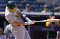 Oakland Athletics designated hitter Sean Murphy breaks his bat on a pitch from New York Yankees relief pitcher Aroldis Chapman (54) as he hits into a triple play in the ninth inning of a baseball game, Sunday, June 20, 2021, at Yankee Stadium in New York. (AP Photo/Kathy Willens)