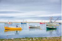 <p>The boats in the bay provide a pop of color on a gray day in Cape Cod.</p>