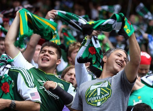 Portland Timbers fans cheer before the start of an MLS soccer game between the Seattle Sounders and the Timbers, Sunday, June 24, 2012, in Portland, Ore. (AP Photo/Rick Bowmer)