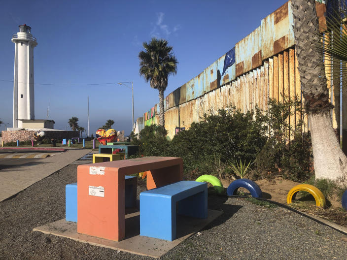 """In Tijuana, the Mexican side of a cross-border garden, is located in a popular recreational area on the Pacific Ocean, Saturday, Jan. 25, 2020. The U.S. Border Patrol, reacting to a breach it discovered in a steel-pole border wall believed to be used by smugglers, gave activists no warning this month when it bulldozed the U.S. side of the cross-border garden on an iconic bluff overlooking the Pacific Ocean. On Saturday, after a public apology for """"the unintentional destruction,"""" the agency allowed the activists in a highly restricted area to resurrect the garden. (AP Photo/Elliot Spagat)"""
