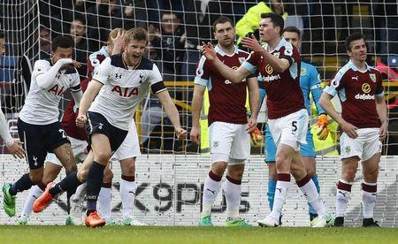 Tottenham's Eric Dier celebrates scoring their first goal with Dele Alli as Burnley's Michael Keane looks dejected
