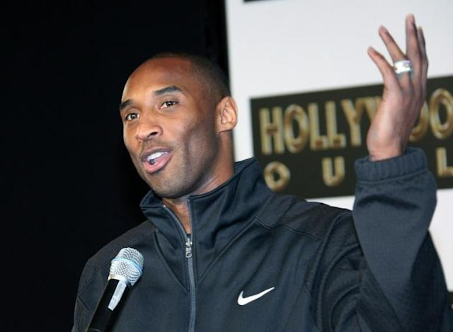 Former Los Angeles Lakers star Kobe Bryant, killed last month in a plane crash, is shown at a 2011 hand and footprint ceremony at Grauman's Chinese Theater, the casting of which is among the items set to be put on the auction block in April (AFP Photo/David Livingston)