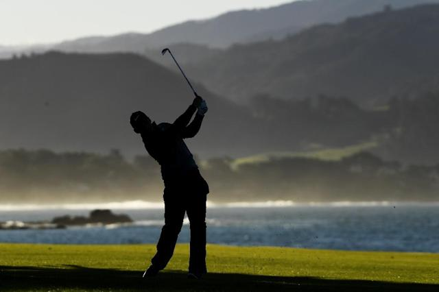 England's Paul Casey plays his second shot at the 18th hole on Monday on his way to a runner-up showing at the PGA Pebble Beach Pro-Am (AFP Photo/Harry How)