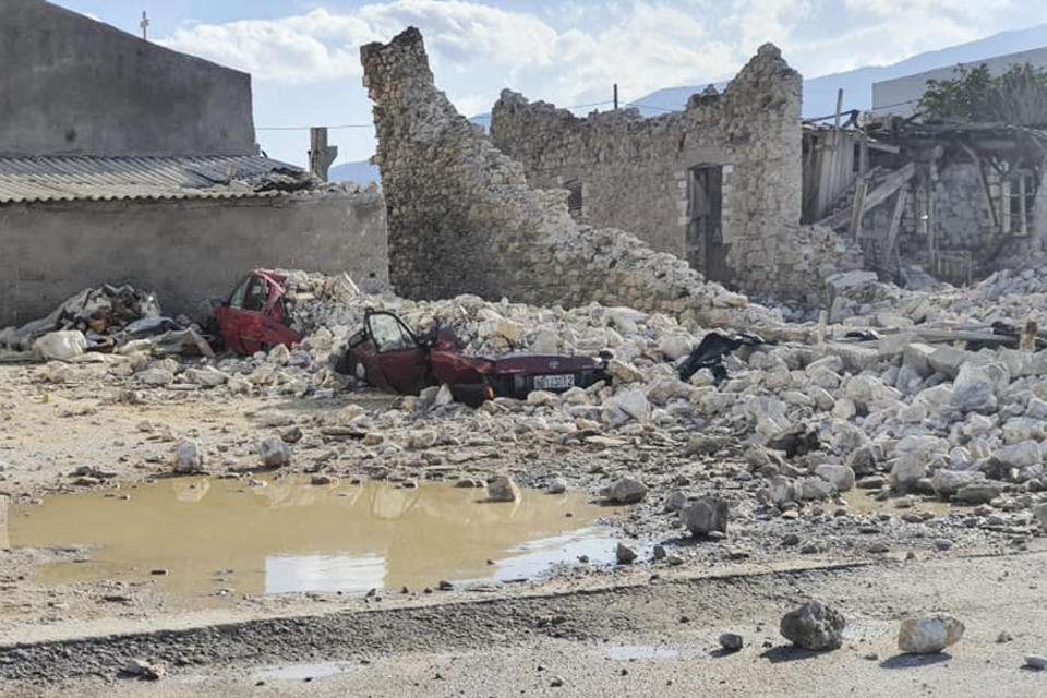 This picture shows destroyed car and collapsed buildings after an earthquake in the island of Samos on October 30, 2020. - A powerful earthquake hit Greece and Turkey on October 30, 2020, causing buildings to collapse and a sea surge that flooded streets in the Turkish resort city of Izmir. Greek public television said the quake also caused a mini-tsunami on the eastern Aegean Sea island of Samos, damaging buildings. The US Geological Survey said the 7.0 magnitude quake was registered 14 kilometres (8.6 miles) off the Greek town of Karlovasi on Samos. (Photo by STR / Eurokinissi / AFP) (Photo by STR/Eurokinissi/AFP via Getty Images)