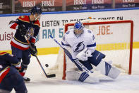 Tampa Bay Lightning goaltender Andrei Vasilevskiy (88) saves a shot on goal during the first period of an NHL hockey game against the Florida Panthers, Saturday, May 8, 2021, in Sunrise, Fla. (AP Photo/Mary Holt)