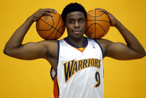 FILE - In this Monday, Oct. 3, 2005 file photo, The Golden State Warriors first round draft pick, Ike Diogu from Arizona State, poses for the team photographer at Media Day at their headquarters in downtown Oakland, Calif. USA. The 2005 NBA Draft had its share of international players, but Ike Diogu was the lone Nigerian-American, but now fifteen years later, Nigerians are setting records. (AP Photo/Dino Vournas, File)