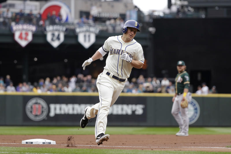 Seattle Mariners' Kyle Seager rounds the bases on his two-run home run against the Oakland Athletics in the first inning of a baseball game Sunday, Sept. 29, 2019, in Seattle. (AP Photo/Elaine Thompson)