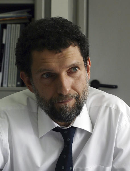 FILE - April 29, 2015 file photo of Osman Kavala, taken in Istanbul. Kavala, a Turkish businessman and activist who was arrested a year ago and no an indictment has been issued yet. Under global scrutiny, Turkey vows to get to the bottom of the alleged killing of a Saudi journalist at the kingdom's consulate in Istanbul. But some observers see a double standard in promises of transparency from a government accused of stifling freedom of expression. (AP Photo, File)