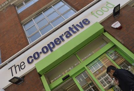 A customer enters a branch of a Co-operative food store in central London