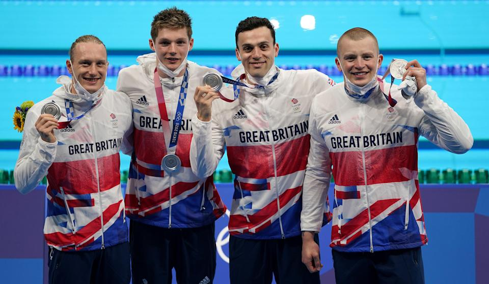 Great Britain's (left-right) Luke Greenbank, Duncan Scott, James Guy and Adam Peaty after winning the silver medal in the men's 4x100m medley relay (Joe Giddens/PA) (PA Wire)