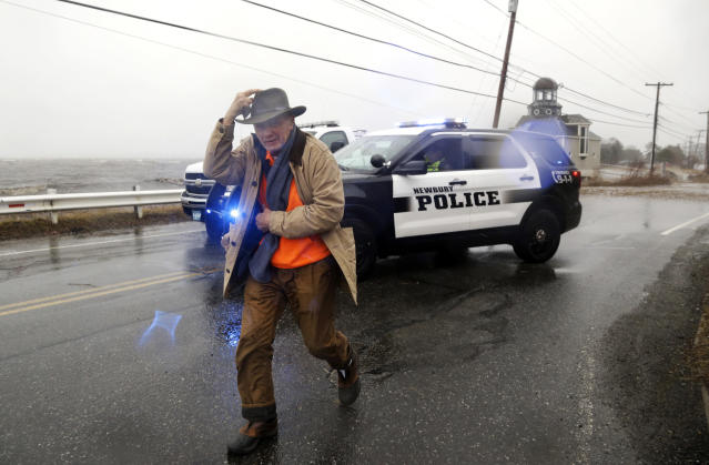 <p>A pedestrian walks away after being told by police that a flooded roadway towards Plum Island is closed Friday, March 2, 2018, in Newburyport, Mass., as a major nor'easter pounds the East Coast, packing heavy rain, intermittent snow and strong winds. The Eastern Seaboard is expected to be buffeted by wind gusts exceeding 50 mph, with possible hurricane-strength winds of 80 to 90 mph on Cape Cod. (Photo: Elise Amendola/AP) </p>
