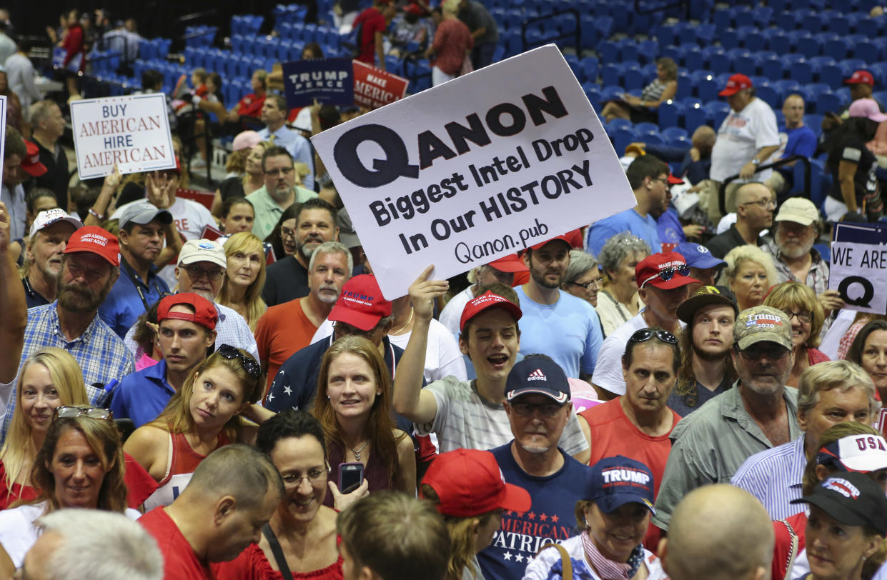 Trump supporters displaying QAnon posters appeared at one of President Trump's Make America Great Again rallies in 2018. (Photo: Thomas O'Neill/NurPhoto via Getty Images)