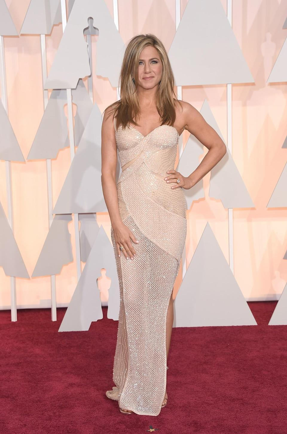 <p>The actress wowed in a nude beaded gown by Atelier Versace at the 2015 Oscars. <i>[Photo: Getty]</i> </p>