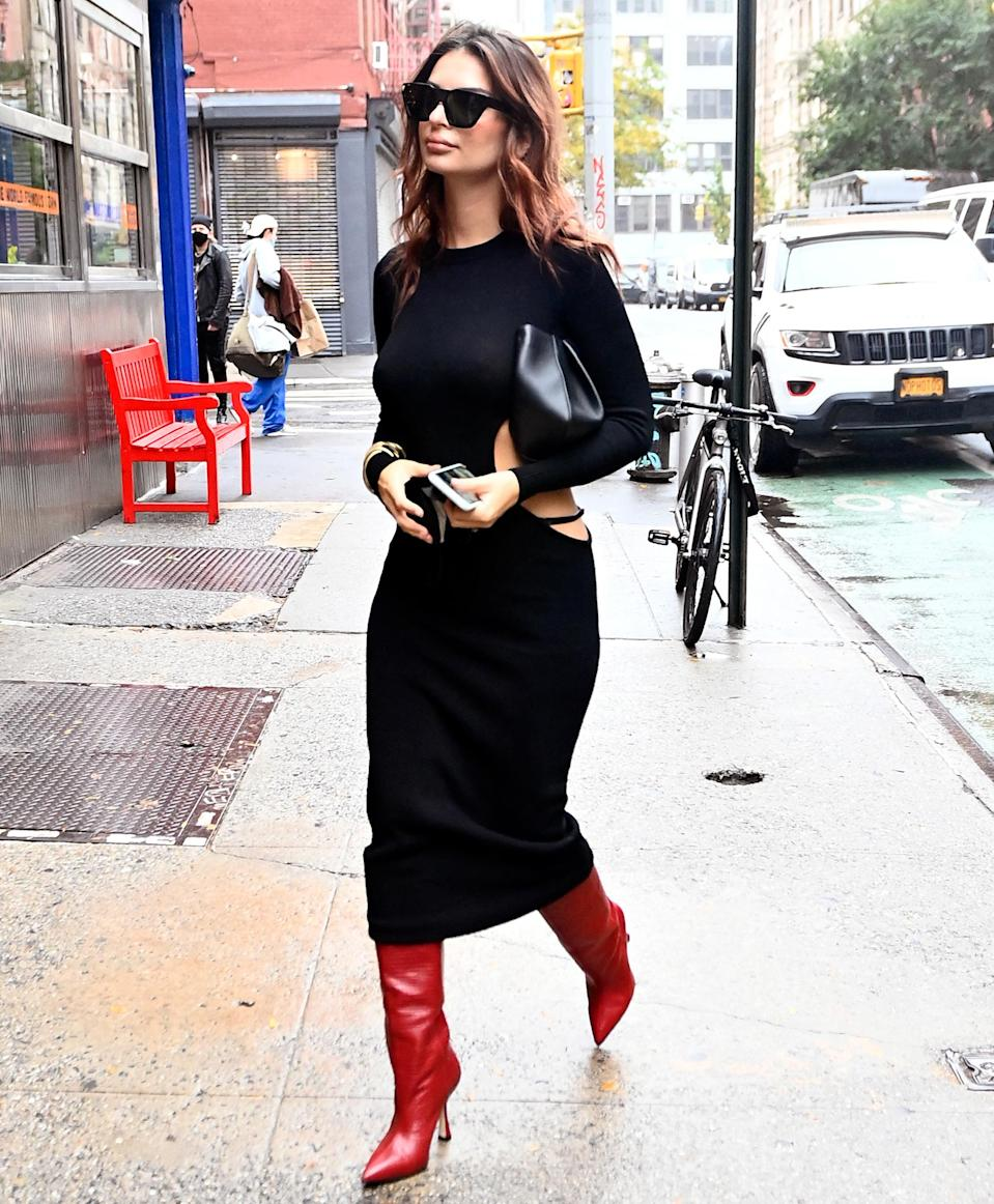 "<p>Emily Ratajkowski steps out in N.Y.C. on Oct. 26 after announcing that she and husband Sebastian Bear-McClard are <a href=""https://people.com/parents/emily-ratajkowski-pregnant-expecting-first-child-vogue/"" rel=""nofollow noopener"" target=""_blank"" data-ylk=""slk:expecting their first child together."" class=""link rapid-noclick-resp"">expecting their first child together. </a></p>"