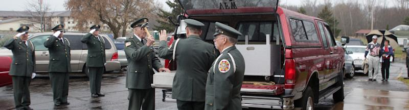 LeRoy Grosskreutz of the VFW Post 388 Honor Guard uses a hammer to ring a bell during Veterans Day ceremonies at VFW Post 388 in Wausau, Wis., Sunday, Nov. 11, 2012. (AP Photo/Wausau Daily Herald, Dan Young)