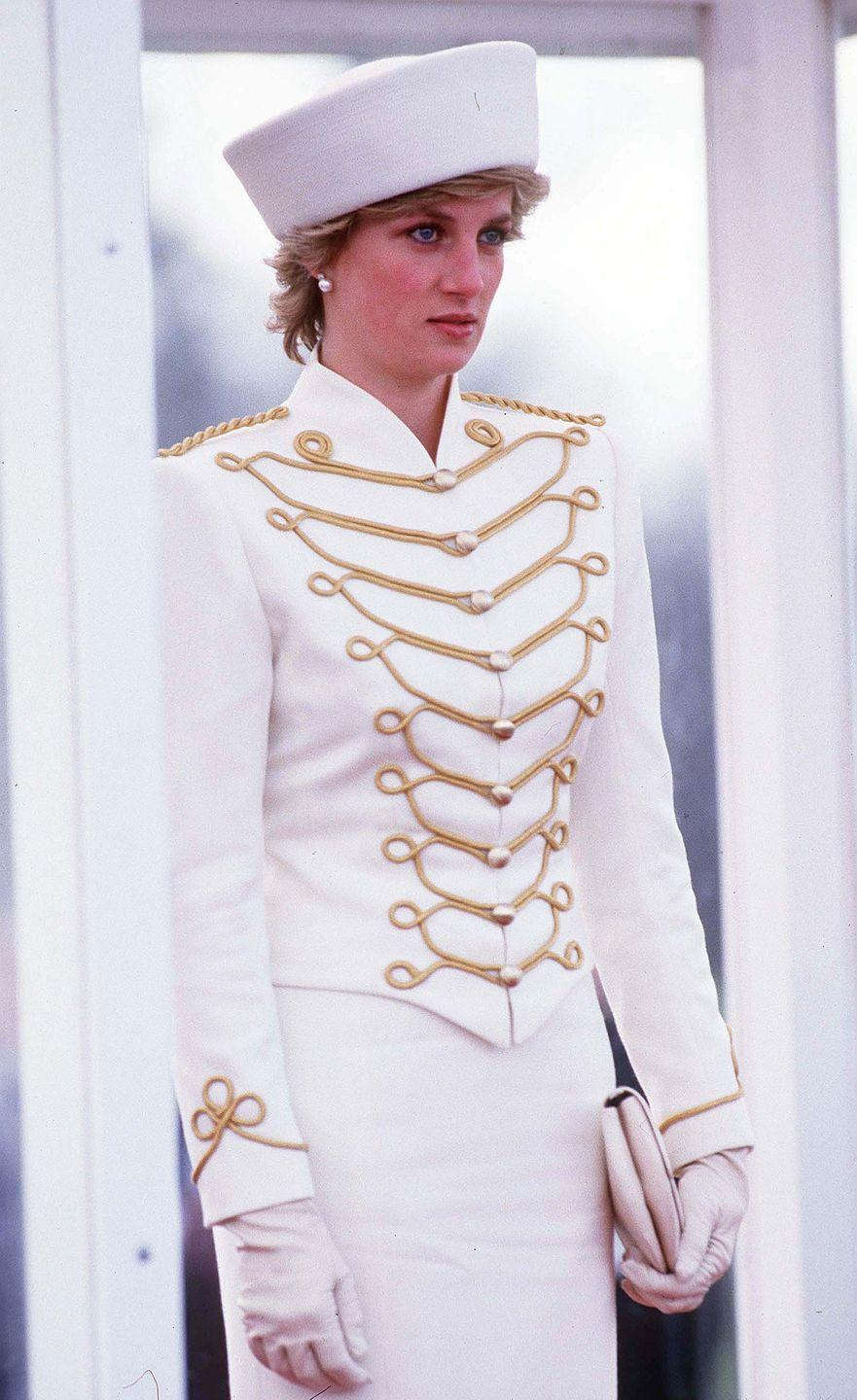<p>Diana wears this impeccably tailored military-style jacket so well, we wish we had our own.</p>