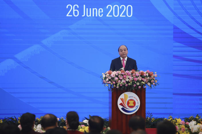 Vietnamese Prime Minister Nguyen Xuan Phuc delivers a speech at the opening ceremony of the 36th ASEAN Summit in Hanoi, Vietnam Friday, June 26, 2020. Leaders from the Southeast Asian ten-nation bloc hold the bi-annual summit via online video conference to discuss regional issues. (AP Photo/Hau Dinh)