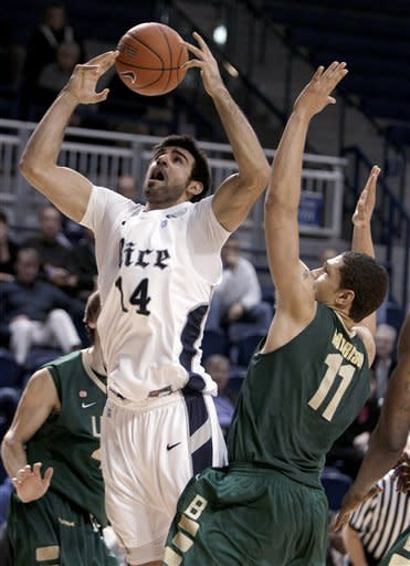 Rice forward Arsalan Kazemi (14) loses the handle on the ball as he goes to the basket against UAB forward Herb Harrison (11) during the second half of an NCAA college basketball game Wednesday, Jan. 18, 2012, in Houston. UAB beat Rice 61-60. (AP Photo/Houston Chronicle, Brett Coomer) MANDATORY CREDIT