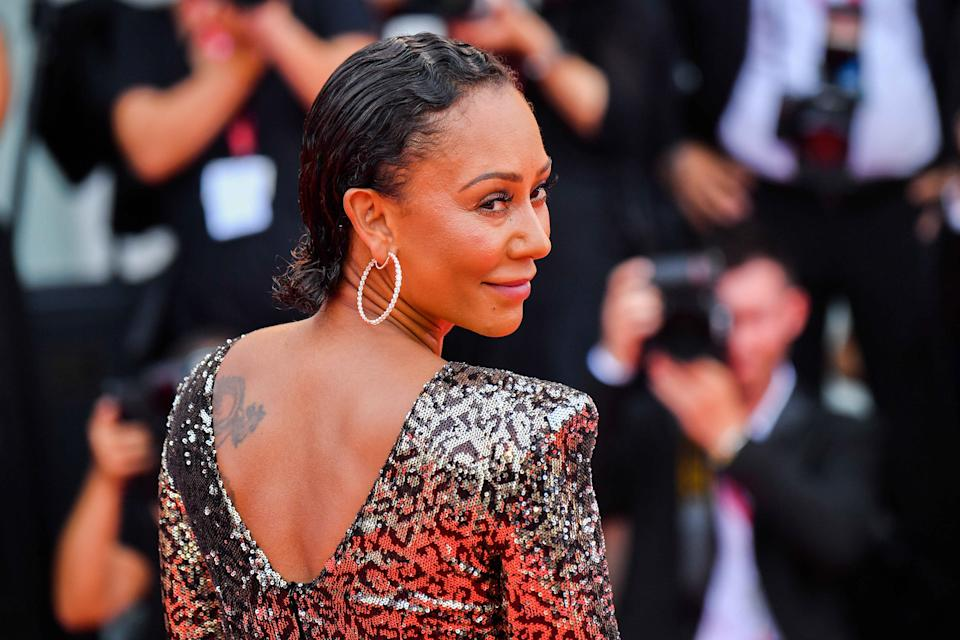 Melanie Brown walks the red carpet ahead of the opening ceremony during the 76th Venice Film Festival at Sala Casino on August 28, 2019 in Venice, Italy. (Photo by Stephane Cardinale - Corbis/Corbis via Getty Images)