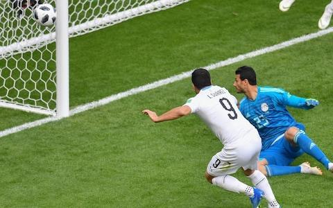 A Jose Gimenez header on the verge of 90 minutes gave Uruguay a hard-fought 1-0 win over Egypt at the Yekaterinburg Arena, as what could have been a tale of two strikers was decided by a centre-back. There were high hopes for the Egyptians before kick-off as birthday boy Mohamed Salah was named among the substitutes, having recovered ahead of schedule from an injury sustained in the Champions League final. Every single time his face was shown on the big screens around the stadium the noise levels amplified, but Hector Cuper remained unswayed by emotion and stayed resolute in his decision making. Salah has other, more winnable fights to be prepared for, and keeping Egypt's star player rested may prove to be the right one going forward, especially considering how vulnerable Saudi Arabia looked on Thursday and how average Russia should prove to be. Another (now ex) star of Liverpool was instead the focus of much of this game and not for good reason. Luis Suarez summed up Uruguay's struggles to find anything like cohesion or fluency with an awful performance, losing possession all over the pitch, passing to the wrong people and hitting the side netting in the first half when it looked easier to score. Later, with only the goalkeeper to beat, Suarez held on the ball for too long and allowed goalkeeper Ahmed El-Shenawy the opportunity to smother inside the six yard box. For the umpteenth time in the game, Suarez berated himself, apparently unsure as to how just why nothing he attempted was working. If Egypt missed Salah, Uruguay were actively hindered by the presence of their misfiring Suarez imposter. Suarez misses a great chance inside the six yard box Credit: REUTERS Egypt frustrated Uruguay with a deep defensive line, staying compact, dealing with danger competently and threatening on the counter-attack but as they grew tired towards the end, Uruguay showed their quality and slowly squeezed the neck of the game. Edison Cavani came closest to breaking the deadlock with