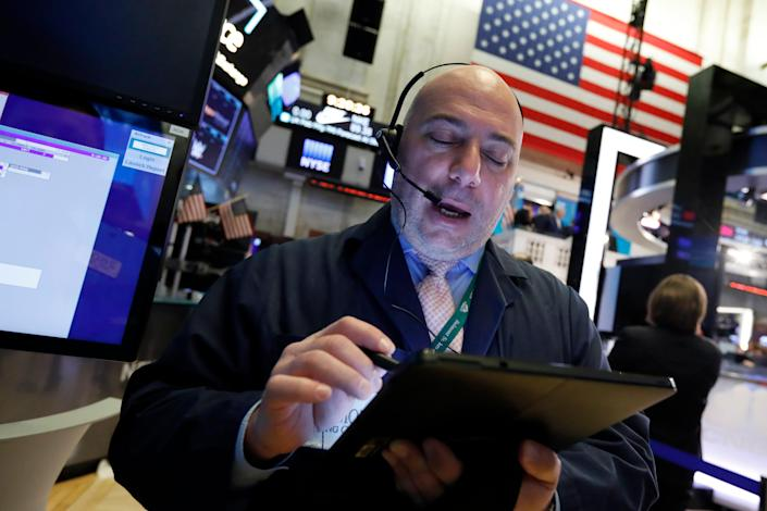 Trader Vincent Napolitano works on the floor of the New York Stock Exchange, Monday, March 2, 2020.