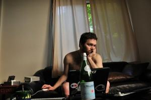 Slob working from home with beer and in underwear