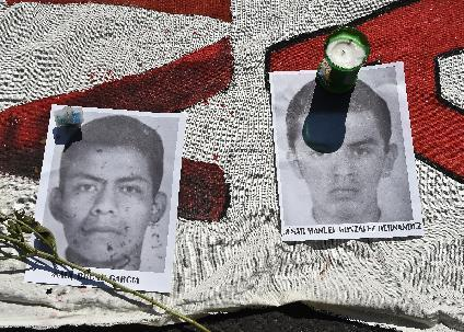 Portraits of disappeared students are displayed during a protest in Mexico City, on October 8, 2014 (AFP Photo/Ronaldo Schemidt)