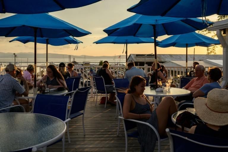 Maskless diners at a restaurant by Lake Champlain in Burlington, Vermont on June 28, 2021