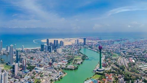 """<span class=""""caption"""">Colombo with the Port City development in the distance. </span> <span class=""""attribution""""><a class=""""link rapid-noclick-resp"""" href=""""https://www.shutterstock.com/image-photo/colombo-aerial-shot-iconic-places-sri-1745929967"""" rel=""""nofollow noopener"""" target=""""_blank"""" data-ylk=""""slk:Rakhitha_w/Shutterstock"""">Rakhitha_w/Shutterstock</a></span>"""