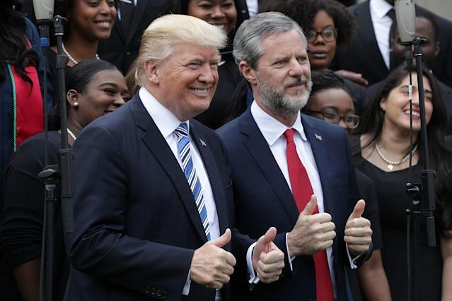 Trump and Falwell pose for photos at the Liberty University commencement in Lynchburg, Va., May 13, 2017. (Alex Wong/Getty Images)