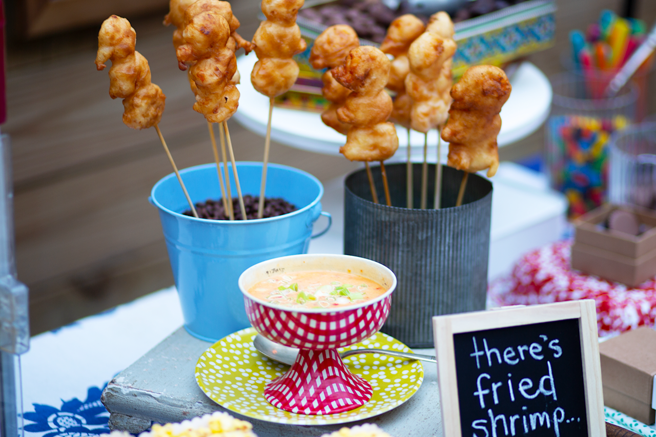 """<p>No Southern bash is complete without a scrumptious recipe. Choose a main dish that complements the theme of the movie. We went with boom boom shrimp in honor of the beloved <i>Forrest Gump </i>character, Bubba Blue. Get the recipe <a href=""""https://www.southernliving.com/recipes/boom-boom-shrimp"""">here</a>.</p>"""