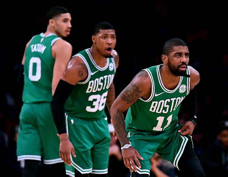 (From R) Kyrie Irving, Marcus Smart and Jayson Tatum of the Boston Celtics get back on defense during a NBA game against the Los Angeles Lakers, in Los Angeles, California, on January 23, 2018