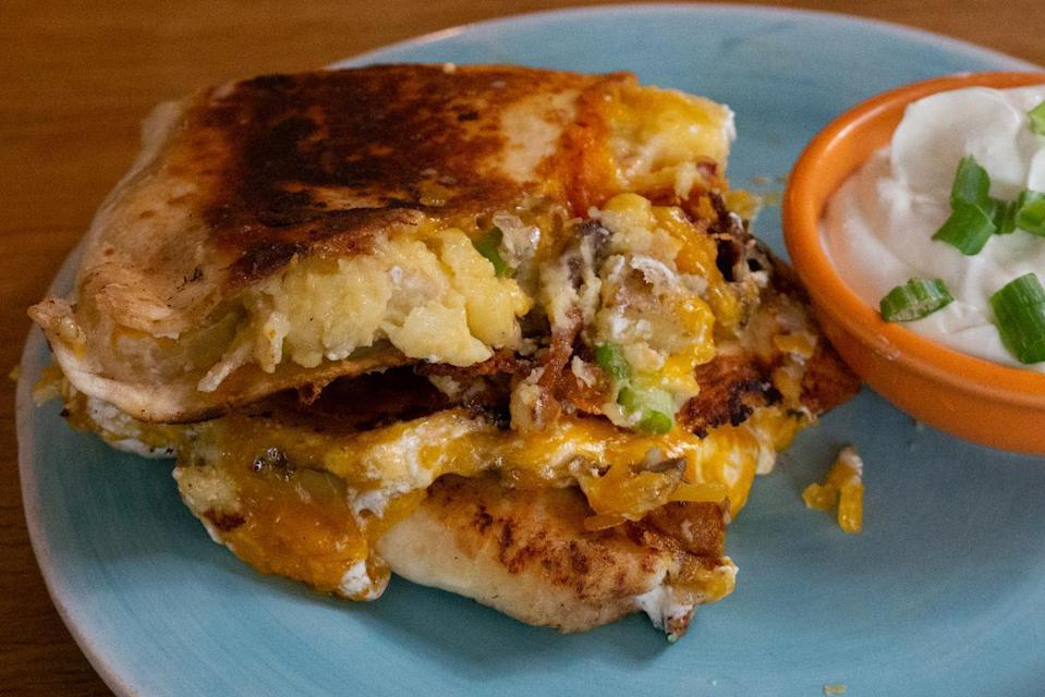 """<p>Quesadillas are one of the <a href=""""https://www.thedailymeal.com/cook/best-mexican-recipes?referrer=yahoo&category=beauty_food&include_utm=1&utm_medium=referral&utm_source=yahoo&utm_campaign=feed"""" rel=""""nofollow noopener"""" target=""""_blank"""" data-ylk=""""slk:best Mexican dishes to make at home"""" class=""""link rapid-noclick-resp"""">best Mexican dishes to make at home</a>. This easy 10-minute recipe works with any leftover potatoes. </p> <p><a href=""""https://www.thedailymeal.com/recipes/mashed-potato-quesadillas-recipe?referrer=yahoo&category=beauty_food&include_utm=1&utm_medium=referral&utm_source=yahoo&utm_campaign=feed"""" rel=""""nofollow noopener"""" target=""""_blank"""" data-ylk=""""slk:For the Mashed Potato Quesadillas recipe, click here."""" class=""""link rapid-noclick-resp"""">For the Mashed Potato Quesadillas recipe, click here.</a></p>"""