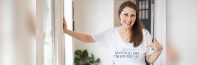 """Woman wearing a tshirt that says """"Dear Gluten, We are never ever getting back together."""""""