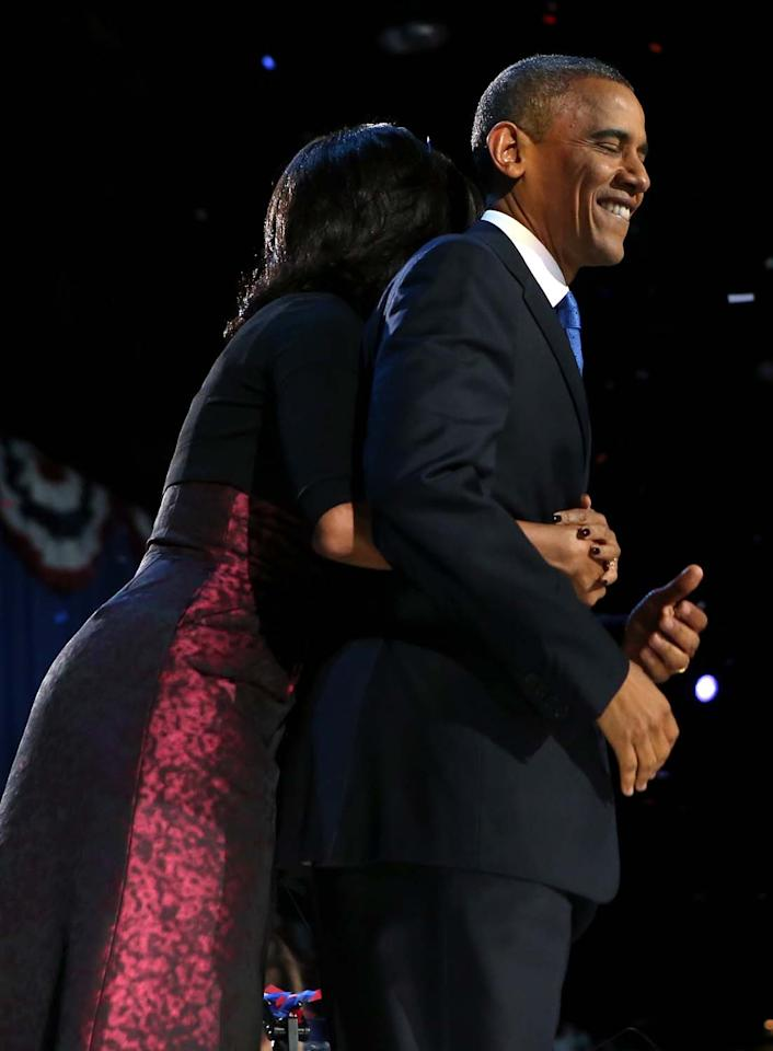 CHICAGO, IL - NOVEMBER 06:  U.S. President Barack Obama stands on stage with first lady Michelle Obama after his victory speech on election night at McCormick Place November 6, 2012 in Chicago, Illinois. Obama won reelection against Republican candidate, former Massachusetts Governor Mitt Romney.  (Photo by Chip Somodevilla/Getty Images)