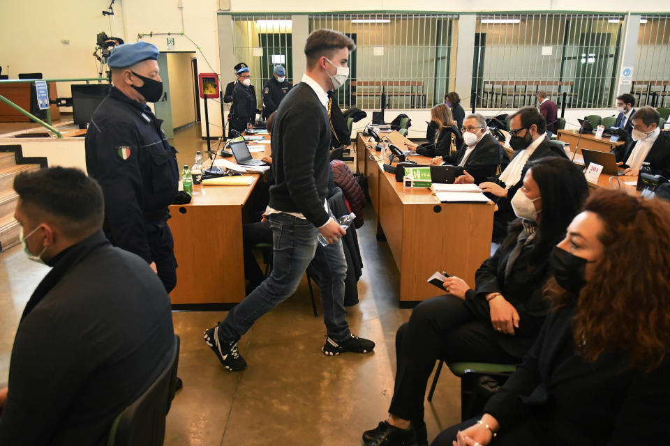 Gabriel Natale-Hjorth, center, from the United States, walks past to Rosa Maria Esilio, widow of slain Carabinieri military police officer Mario Cerciello Rega, bottom right, and Paolo Cerciello Rega, brother of Mario, left, prior to a hearing in the trial where he and Finnegan Lee Elder are accused of slaying a plainclothes Carabinieri officer while on vacation in Italy in July 2019, in Rome, Monday, March 1, 2021. (Alberto Pizzoli/Pool Photo via AP)