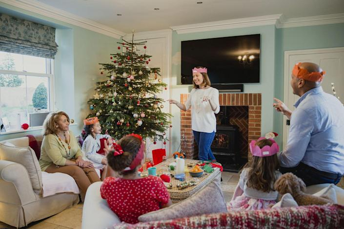 """<p><a href=""""https://www.housebeautiful.com/entertaining/holidays-celebrations/advice/g999/christmas-home-decor-1110/"""" rel=""""nofollow noopener"""" target=""""_blank"""" data-ylk=""""slk:Christmas"""" class=""""link rapid-noclick-resp"""">Christmas</a> is a time for joy, giving, and—most importantly—some festive <a href=""""https://www.housebeautiful.com/lifestyle/fun-at-home/g37636479/christmas-activities/"""" rel=""""nofollow noopener"""" target=""""_blank"""" data-ylk=""""slk:family fun"""" class=""""link rapid-noclick-resp"""">family fun</a>. We're not talking about your regular old <a href=""""https://www.housebeautiful.com/entertaining/holidays-celebrations/g34236289/secret-santa-gifts/"""" rel=""""nofollow noopener"""" target=""""_blank"""" data-ylk=""""slk:Secret Santa"""" class=""""link rapid-noclick-resp"""">Secret Santa</a> exchange here, either. We've put together a list of the best Christmas <a href=""""https://www.housebeautiful.com/room-decorating/living-family-rooms/g26090946/game-room-ideas/"""" rel=""""nofollow noopener"""" target=""""_blank"""" data-ylk=""""slk:games"""" class=""""link rapid-noclick-resp"""">games</a> for you and your loved ones to enjoy this holiday season, whether you're gathering with an enormous family or looking for some smaller-scale ways to entertain your kids. Whether you want to get active or cozy up around a fire, the holiday family game ideas ahead will help you make the most of being home for the holidays. </p>"""