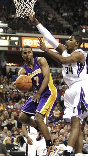 Los Angeles Lakers guard Ramon Sessions, left, passes off against Sacramento Kings forward Jason Thompson during the first half of an NBA basketball game in Sacramento, Calif., Thursday, April 26, 2012. (AP Photo/Rich Pedroncelli)