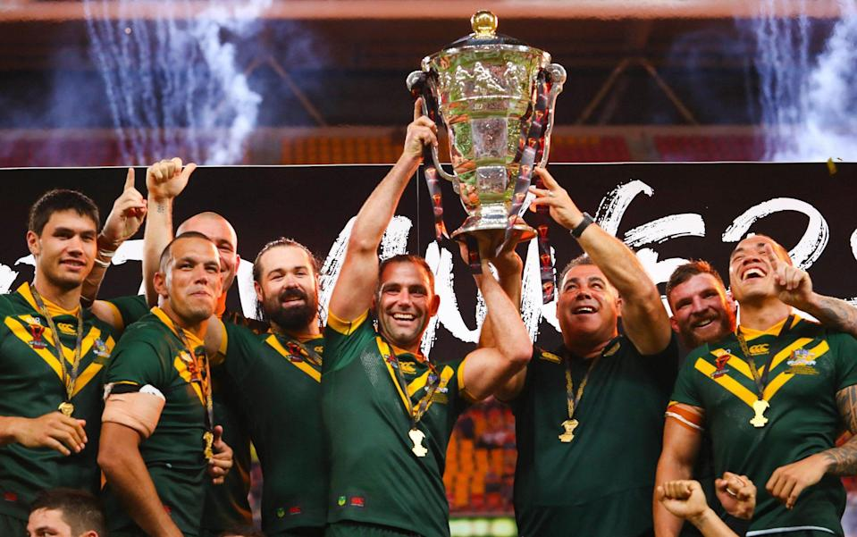 """This file photo taken on December 2, 2017 shows Australia celebrating their victory in the Rugby League World Cup men's final match between Australia and England in Brisbane. - Australia and New Zealand pulled out of the 2021 Rugby World Cup in England on July 22, 2021 citing """"player welfare and safety"""" concerns during the Covid-19 pandemic - AFP via Getty Images"""