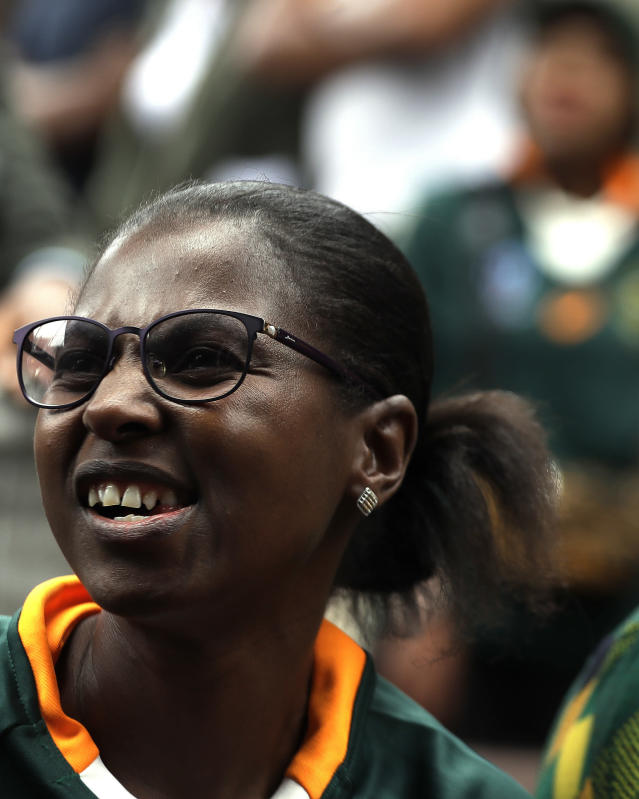 A South African fan celebrates at Vilakazi street in Soweto, South Africa, after their team's victory in the Rugby World Cup final between South Africa and England being played in Tokyo, Japan from Saturday Nov. 2, 2019. South Africa defeated England 32-12. (AP Photo/Themba Hadebe)
