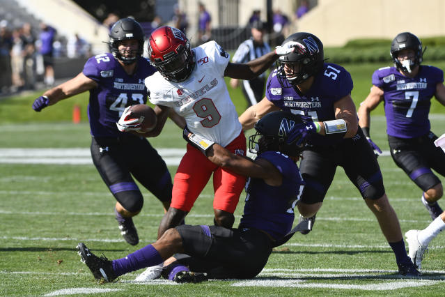 UNLV wide receiver Tyleek Collins (9) runs against Northwestern linebacker Paddy Fisher (42), linebacker Blake Gallagher (51) and defensive back JR Pace, front, during the first half of an NCAA college football game, Saturday, Sept. 14, 2019, in Evanston, Ill. (AP Photo/Matt Marton)