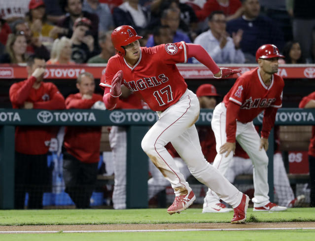 Los Angeles Angels' Shohei Ohtani runs toward home plate to score on a single by Los Angeles Angels' Jose Fernandez during the fourth inning of a baseball game against the Texas Rangers Monday, Sept. 10, 2018, in Anaheim, Calif. (AP Photo/Marcio Jose Sanchez)