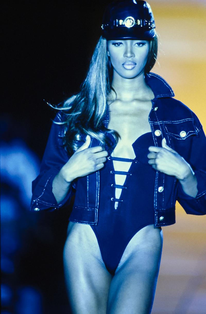 Naomi Campbell walks the runway of the Versace spring/summer 1992 show in 1991. Photo courtesy of Getty Images.