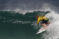 FILE - In this Wednesday, May 16, 2012, file photo, U.S. surfer John John Florence competes to win the Association of Surfing Professionals, ASP, Billabong Rio Pro surfing competition at Barra da Tijuca beach in Rio de Janeiro, Brazil. The geopolitics of the Olympics will be on display when Carissa Moore and John John Florence are in the surf zone. They're two of professional surfing's biggest stars and both compete in the World Surf League under the Hawaii flag. (AP Photo/Felipe Dana, File)