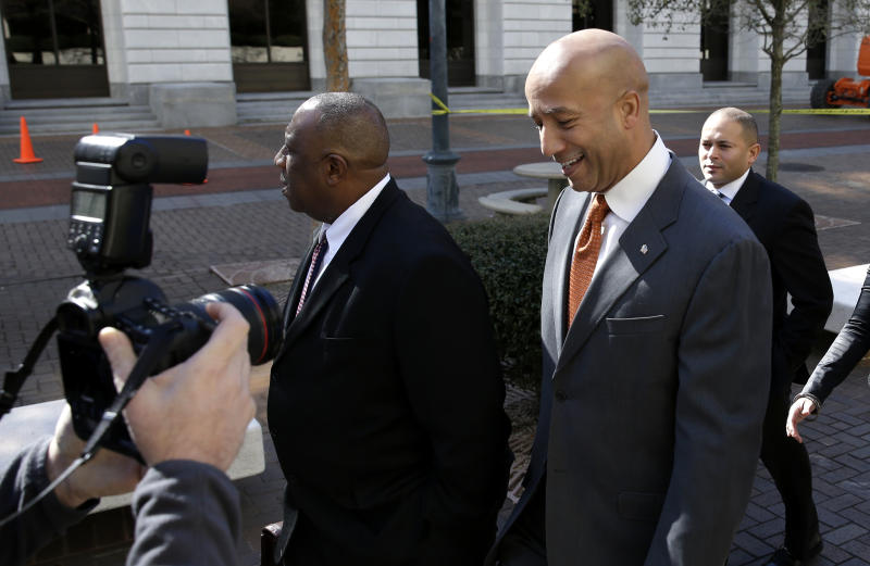 Former New Orleans Mayor Ray Nagin enters Federal Court in for jury selection and possible opening arguments for his corruption trial in New Orleans, Thursday, Jan. 30, 2014. Nagin is charged with accepting bribes, free trips and other gratuities from contractors in exchange for helping them secure millions of dollars in city work. The charges in his 21-count indictment, including bribery and wire fraud, are the product of a City Hall investigation that already has resulted in several convictions or guilty pleas by former Nagin associates. (AP Photo/Gerald Herbert)