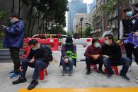 FILE - In this Feb. 5, 2020, file photo, locals wait to buy face masks in Hong Kong. Fear of the spreading coronavirus has led to a global run on sales of face masks despite medical experts' advice that most people who aren't sick don't need to wear them. (AP Photo/Vincent Yu, File)