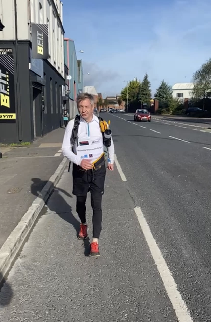 Michael Ferndale pounds the streets of Belfast in reverse on day two of his unique challenge