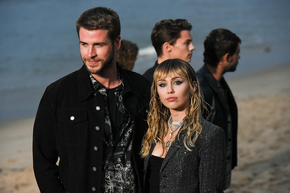 MALIBU, CALIFORNIA - JUNE 06: Liam Hemsworth and Miley Cyrus at Saint Laurent mens spring summer 20 show on June 06, 2019 in Malibu, California. (Photo by Presley Ann/WireImage,)